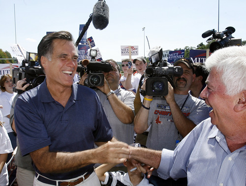 FILE - In this Sept. 3, 2007, file photo Republican presidential hopeful, former Massachusetts governor Mitt Romney, left, shakes hands with Democratic presidential hopeful, U.S. Sen. Chris Dodd, D-Conn., at the Labor Day parade in Milford, N.H. Romney also crossed paths at the parade with another rising political star and presidential contender, Barack Obama, as both sought to line up votes in the New Hampshire primary. They shook hands, exchanged a few pleasantries and turned their attention to the voters. When they stand side by side on the presidential debate stage Wednesday night, Oct. 3, 2012, it will be one of the few times they have ever even met in person. (AP Photo/Jim Cole, File)