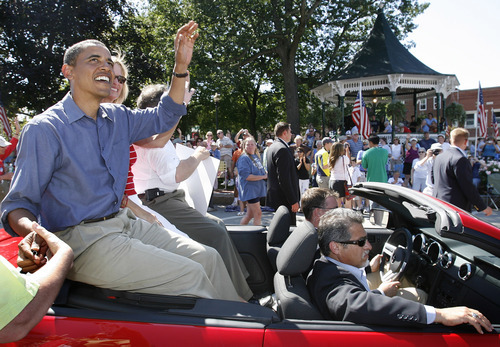 FILE - In this Sept. 3, 2007, file photo Democratic presidential hopeful, U.S. Sen Barack Obama, D-Ill., waves as he rides in the Labor Day parade in Milford, N.H. Obama crossed paths at the parade with another rising political star and presidential contender, Mitt Romney, as both sought to line up votes in the New Hampshire primary. They shook hands, exchanged a few pleasantries and turned their attention to the voters. When they stand side by side on the presidential debate stage Wednesday night, Oct. 3, 2012, it will be one of the few times they have ever even met in person. (AP Photo/Jim Cole, File)