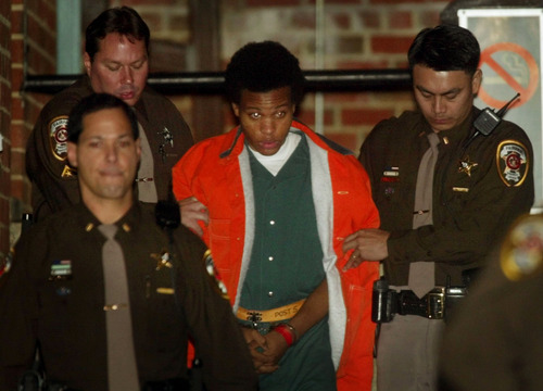 FILE - In this Tuesday, Jan. 14, 2003 file photo, sniper shooting suspect John Lee Malvo is escorted from court after his preliminary hearing in Fairfax, Va. Convicted D.C. sniper Malvo said in a newspaper interview published Sunday, Sept. 30, 2012, that the devastated reaction of a victim's husband made him feel like