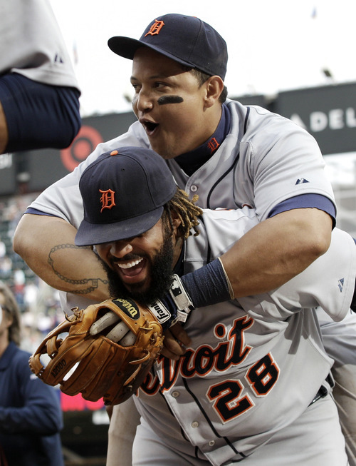 Jim Mone | The Associated Press The Detroit Tigers' Miguel Cabrera, top, hitches a short ride on Prince Fielder after the Tigers beat the Minnesota Twins 2-1 Sunday on Fielder's two-run homer.