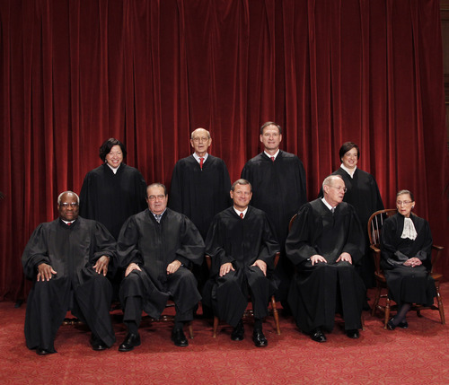 FILE - This Oct. 8, 2010 file photo shows the justices of the U.S. Supreme Court in a group portrait at the Supreme Court Building in Washington. The Supreme Court is embarking on a new term beginning Monday, Oct. 1, 2012, that could be as consequential as the last one with the prospect for major rulings about affirmative action, gay marriage and voting rights. Seated from left to right are: Associate Justice Clarence Thomas, Associate Justice Antonin Scalia, Chief Justice John G. Roberts, Associate Justice Anthony M. Kennedy, Associate Justice Ruth Bader Ginsburg. Standing, from left are: Associate Justice Sonia Sotomayor, Associate Justice Stephen Breyer, Associate Justice Samuel Alito Jr., and Associate Justice Elena Kagan. (AP Photo/Pablo Martinez Monsivais)