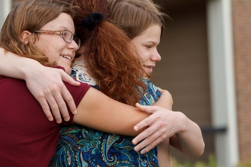 Trent Nelson  |  The Salt Lake Tribune Garrett Lines, right, and his sister Kiercy embrace their mother, Nikki Lines in Midvale on Thursday, Sept. 6, 2012.  Garrett has autism and lives in a group home after his mother turned him over to the child welfare system a few years ago.