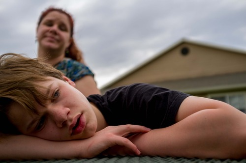 Trent Nelson  |  The Salt Lake Tribune Garrett Lines is a teenager with autism who lives in a group home after his mother, Nikki Lines (at rear), turned him over to the child welfare system a few years ago. Lines was photographed in Midvale, Utah, Thursday, September 6, 2012.