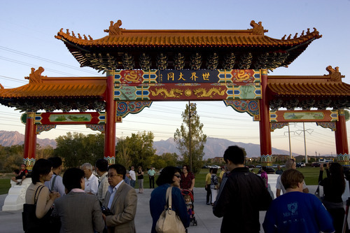 Kim Raff |  The Salt Lake Tribune People walk around the Chinese Heritage Gate after the unveiling at the Utah Cultural Center in West Valley City, Utah on September 29, 2012. The gate, which is a symbol of friendship between West Valley City and Nantou, Taiwan. has come under scrutiny. Some members of the Asian community are upset about how funding for the gate has been handled.