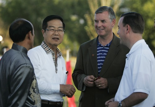Kim Raff |  The Salt Lake Tribune Board chairman Terence Chen, left, Lee Chao-Ching, magistrate of Nantou County, Taiwan, Salt Lake County Mayor Peter Corroon and West Valley City Mayor Mike Winder talk after the unveiling of the Chinese Heritage Gate at the Utah Cultural Center in West Valley City, Utah on September 29, 2012. The gate, which is a symbol of friendship between West Valley City and Nantou, Taiwan, has come under scrutiny. Some members of the Asian community are upset about how funding for the gate has been handled.