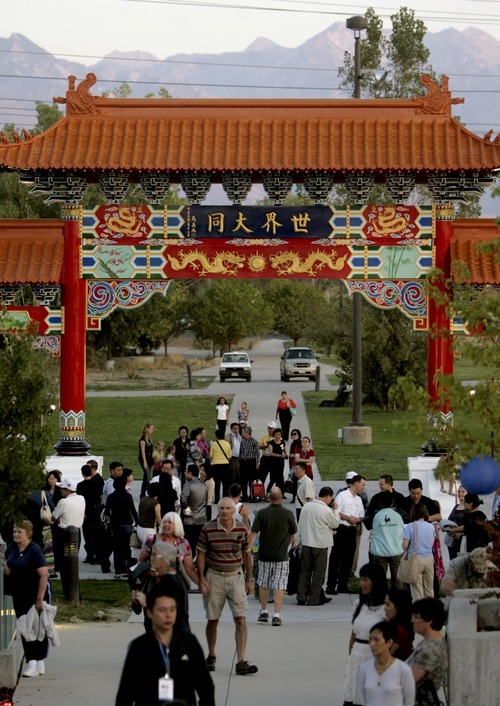 Kim Raff  |  The Salt Lake Tribune People walk around the Chinese Heritage Gate after the unveiling at the Utah Cultural Center in West Valley City, Utah on September 29, 2012. The gate, which is a symbol of friendship between West Valley City and Nantou, Taiwan, has come under scrutiny over its funding.