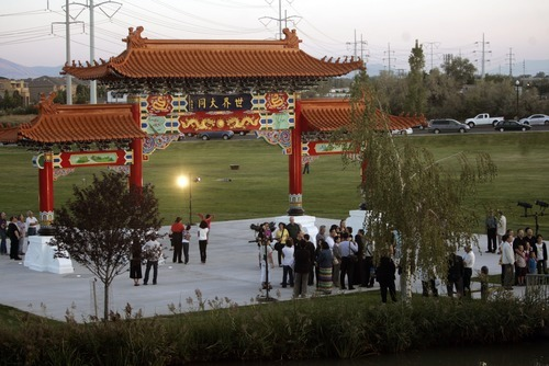 Kim Raff  |  The Salt Lake Tribune People walk around the Chinese Heritage Gate after the unveiling at the Utah Cultural Center in West Valley City, Utah on September 29, 2012. The gate, which is a symbol of friendship between West Valley City and Nantou, Taiwan, has come under scrutiny with some members of the Asian community who are upset about how funds for the gate have been handled.