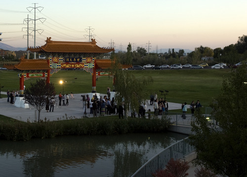 Kim Raff | The Salt Lake Tribune People walk around the Chinese Heritage Gate after the unveiling at the Utah Cultural Center in West Valley City, Utah on September 29, 2012. The gate, which is a symbol of friendship between West Valley City and Nantou, Taiwan has come under scrutiny with some members of the Asian community who are upset about how the money has been handled.