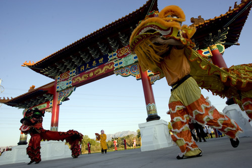 Kim Raff  |  The Salt Lake Tribune Lion dancers from Sil Lum Kung Foo Kwoon dance around the Chinese Heritage Gate during the unveiling at the Utah Cultural Center in West Valley City, Utah on September 29, 2012. The gate, which is a symbol of friendship between West Valley City and Nantou, Taiwan has come under scrutiny with some members of the Asian community who are upset about how the money has been handled.