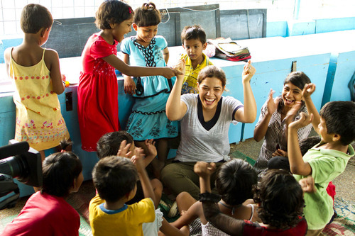 Courtesy photo America Ferrera plays with children at the New Light Crèche in Kolkata, India.