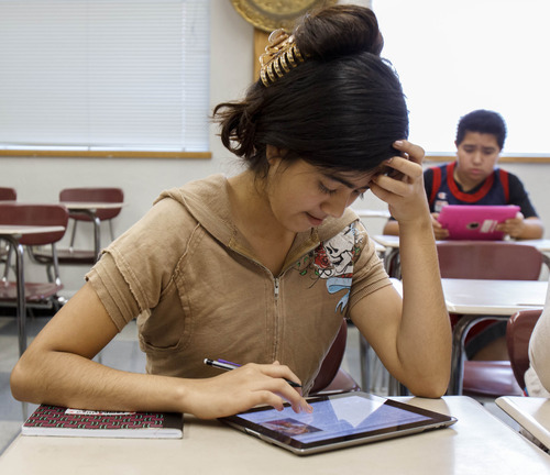 Trent Nelson  |  The Salt Lake Tribune Elizabeth Sibrian, a student at Dixon Middle School in Provo, Utah, uses an iPad in an ESL class, Tuesday September 25, 2012.