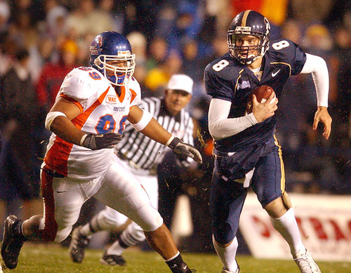 Tribune file photo BYU quarterback Matt Berry scrambles to get away from Boise State's Alex Guerrero during a game in 2003.