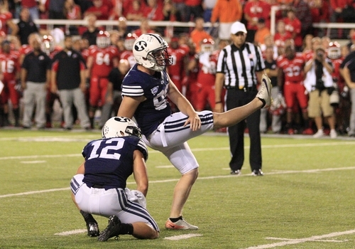 BYU's JD Falslev (12) looks on as BYU Riley Stephenson (99) misses his field goal at the end of their NCAA football game with Utah Saturday, Sept. 15, 2012, in Salt Lake City. Utah defeated BYU 24-21. Stephenson's 36-yard attempt with no time left clanked off the left upright, sending the frenzied crowd back on the field for good to celebrate the upset. (AP Photo/Rick Bowmer)