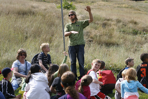 Scott Sommerdorf  |  The Salt Lake Tribune              John Woodruff, the Sundance Mountain Outfitters and Trail Manager speaks to fifth graders from Liberty Elementary in Murray about the wildlife and geography at Sundance Resort, Thursday, September 20, 2012, during their visit to Sundance for a Kids in Nature Program.