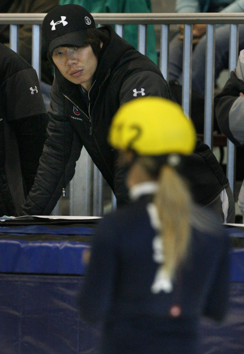 Scott Sommerdorf  |  The Salt Lake Tribune              USA national team assistant coach Jun Hyung Yeo, center, watches skater Jessica Smith glide by during the final day of the U.S. Short-Track Championships at the Utah Olympic Oval in Kearns. As skaters compete to officially qualify for the U.S. team on the World Cup Circuit,  allegations of abuse surrounding suspended head coach Jae Su Chun, and his assistant coach Yeo are still unresolved, Sunday, September 30, 2012.