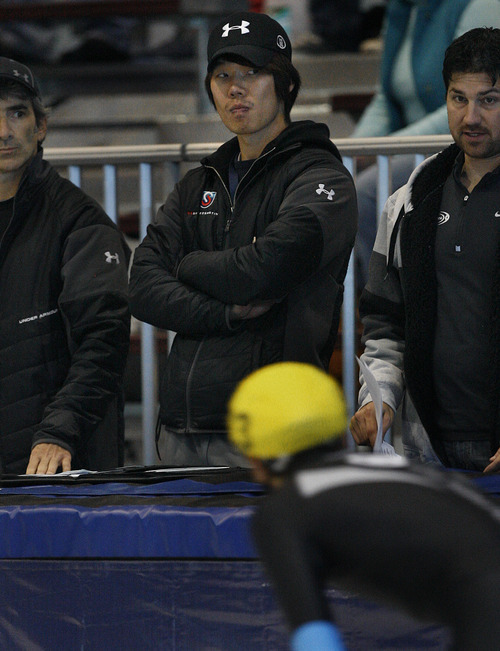 Scott Sommerdorf  |  The Salt Lake Tribune              USA national team assistant coach Jun Hyung Yeo, center, watches during the final day of the U.S. Short-Track Championships at the Utah Olympic Oval in Kearns. As skaters compete to officially qualify for the U.S. team on the World Cup Circuit,  allegations of abuse surrounding suspended head coach Jae Su Chun, and his assistant coach Yeo are still unresolved, Sunday, September 30, 2012.