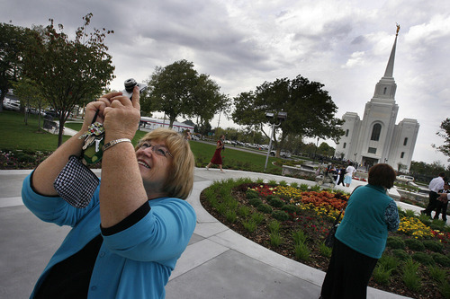Scott Sommerdorf  |  The Salt Lake Tribune              Returned missionary Carol Gibson photographs the old Box Elder Tabernacle after attending the dedication of the new temple in Brigham City was dedicated across the street at 250 South Main Street, Sunday, September 23, 2012.