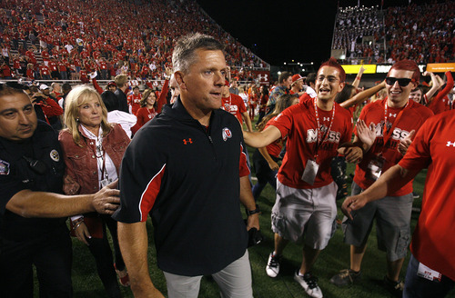Scott Sommerdorf  |  The Salt Lake Tribune              Utah coach Kyle Whittingham heads out to the field after the win to look for Bronco Mendenhall. Utah defeated BYU 24-21, Saturday, September 15, 2012.