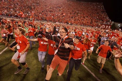 Trent Nelson  |  The Salt Lake Tribune Utah fans rush the field for the second of three times as Utah defeats BYU college football in Salt Lake City, Utah, Saturday, September 15, 2012.