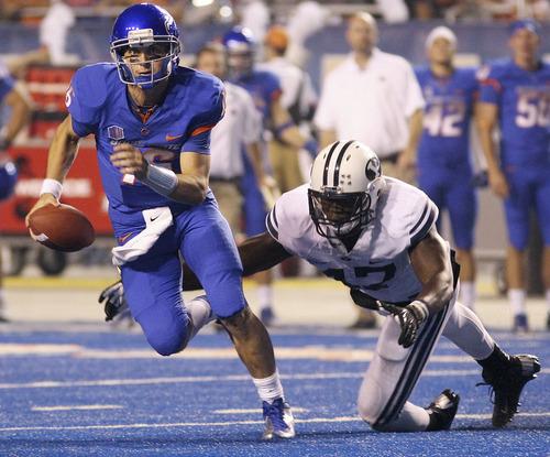 Boise State's Joe Southwick scrambles as Bingham Young's Ezekiel Ansah dives for him during an NCAA college football game Thursday, Sept. 20, 2012, in Boise, Idaho. (AP Photo/The Times-News, Drew Nash)