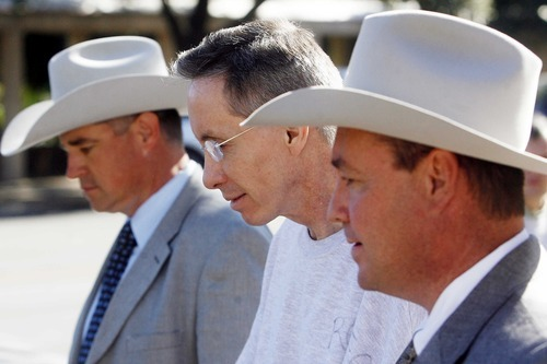 file photo by Patrick Dove/Standard-Times Warren Jeffs, leader of the Fundamentalist Church of Jesus Christ of Latter Day Saints, is taken to a waiting car as he is led out of the Tom Green County Courthouse in Texas in late 2010.