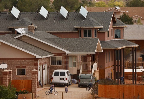 Children ride bikes behind the walls of their home in the twin cities of Hildale, Utah, and Colorado City, Ariz., home to many members of Warren Jeffs' FLDS church.  Trent Nelson/The Salt Lake Tribune