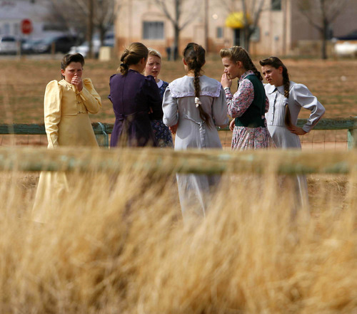 FLDS girls huddle together to protect their privacy, during recess at an FLDS private school in 2006. Photo by Trent Nelson/Salt Lake Tribune