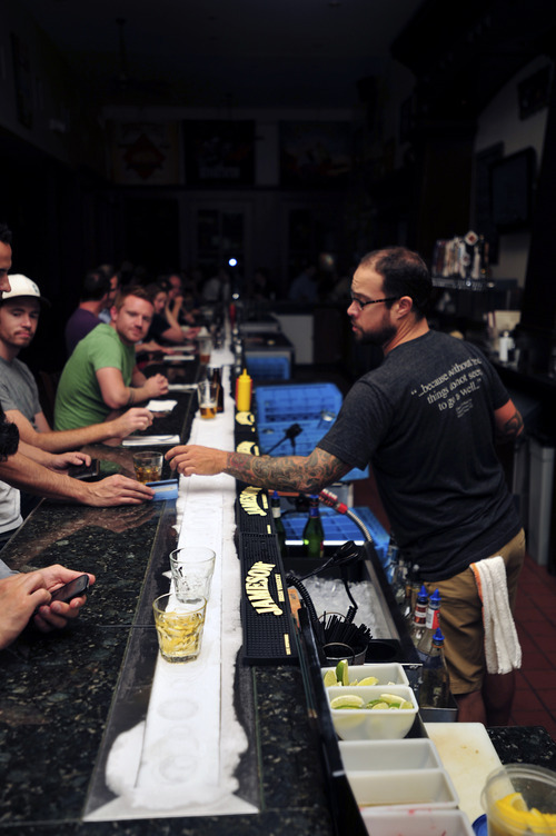 Stephen Speckman | For The Salt Lake Tribune Beerhive Pub's ice bar keeps drinks cool at the last stop on the Utah Heritage Foundation's Thirst Fursdays Historic Pub Crawl, held Sept. 6 and on the first Thursday of each month.