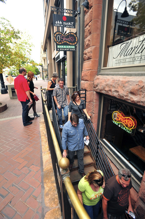 Stephen Speckman | For The Salt Lake Tribune Pub crawlers descend into O'Shucks Bar & Grill during the Utah Heritage Foundation's Thirst Fursdays Historic Pub Crawl, held Sept. 6 and on the first Thursday of each month.