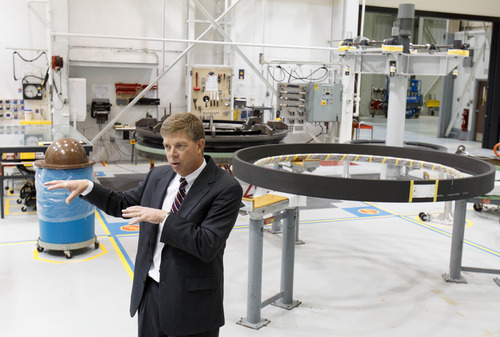 Trent Nelson  |  The Salt Lake Tribune ATK's Jim Nichols explains the production of nozzle components during a tour after ATK and NASA spoke of savings made in manufacturing the solid rocket boosters for NASA's Space Launch System (SLS) Tuesday October 2, 2012 in Promontory, Utah.