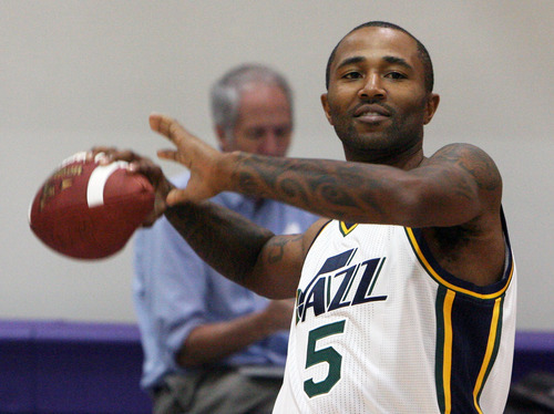 Steve Griffin | The Salt Lake Tribune   New Jazz guard Mo Williams throws a football during Jazz media day in Salt Lake City on Oct. 1, 2012.