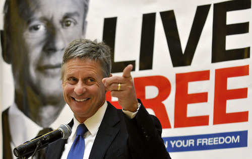 In this Wednesday, Dec. 28, 2011 file photo, former New Mexico Gov. Gary Johnson speaks at a news conference during which he announced he is leaving the Republican Party in favor of seeking a presidential nomination as a Libertarian, at the State Capitol in Santa Fe, N.M.  (AP Photo/Albuquerque Journal, Eddie Moore)