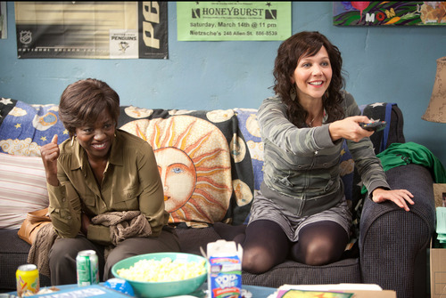This film image released by 20th Century Fox shows Maggie Gyllenhaal, right, and Viola Davis in a scene from