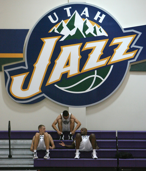 Steve Griffin | The Salt Lake Tribune   Jazz hopefuls Brian Butch, Chris Quinn and Darnell Jackson, talk as they wait to be interviewed during Jazz media day in Salt Lake City on Oct. 1, 2012.