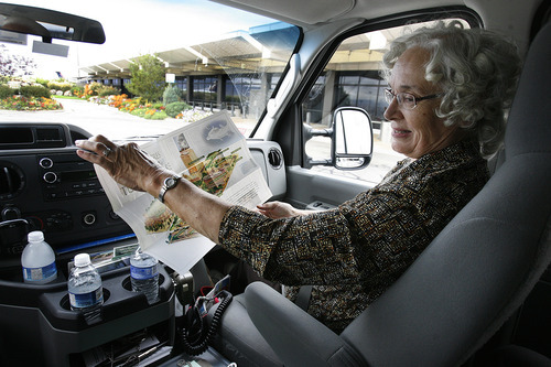 Scott Sommerdorf  |  The Salt Lake Tribune              Margaret Jordan, a volunteer for the shuttle service, unfolds the map of Temple Square for one of her passengers during a free shuttle ride from Salt Lake City International Airport.