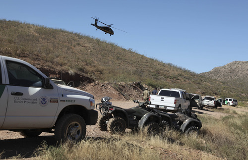 In this photo provided by U.S. Customs and Border Protection, law enforcement forces and equipment gather at a command post in the desert near Naco, Ariz., Tuesday, Oct. 2, 2012, after a Border Patrol agent was shot to death near the U.S.-Mexico line. The agent, Nicholas Ivie, 30, and a colleague were on patrol about 100 miles from Tucson, when shooting broke out shortly before 2 a.m., the Border Patrol said. (AP Photo/U.S. Customs and Border Protection, Gabriel Guerrero)