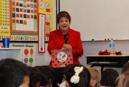 First Lady Jeanette Herbert reads Ladybug Girl and the Bug Squad with students at Jackson Elementary School in Salt Lake City on Wednesday. The event was part of  Jumpstart's 2012 Read for the Record, where more than 2.2 million children nationwide are expected to read Ladybug Girl and the Bug Squad to try to set a new world record for the largest shared reading experience. Courtesy photo