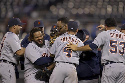Detroit Tigers players celebrate following a baseball game against the Kansas City Royals at Kauffman Stadium in Kansas City, Mo., Monday, Oct. 1, 2012. (AP Photo/Orlin Wagner)