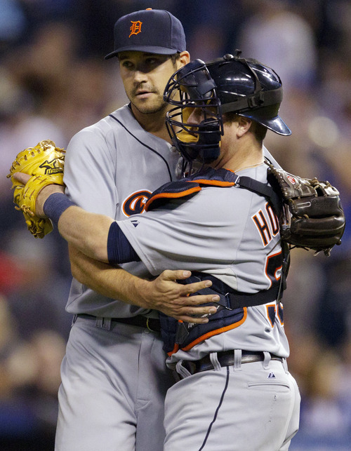 Detroit Tigers relief pitcher Luke Putkonen, left, is congratulated by catcher Bryan Holaday (50) following their 1-0 win over the Kansas City Royals in a baseball game at Kauffman Stadium in Kansas City, Mo., Wednesday, Oct. 3, 2012. (AP Photo/Orlin Wagner)
