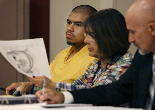 MARTINEZ HEARING Defendant Miguel Mateos-Martinez watches the proceedings as his attorneys Catherine Roberts (center) and Ralph W. Dellapiana work in the foreground. Roberts is holding an artist's sketch of the robber made based on witnesses testimony. Preliminary hearing for Miguel Mateos-Martinez, charged with F1 murder and F1 aggrivated robbery for the 8/15/07 shooting death of