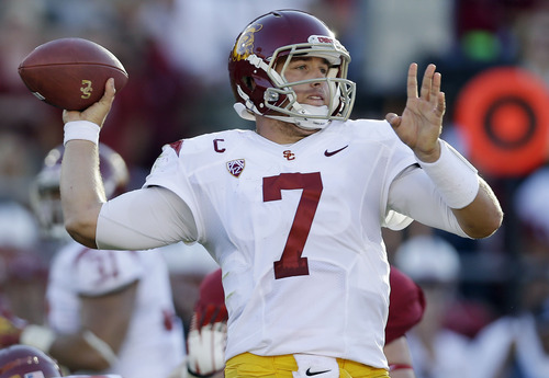 Southern California quarterback Matt Barkley throws against Stanford during the first half of an NCAA college football game in Stanford, Calif., Saturday, Sept.  15, 2012. (AP Photo/Marcio Jose Sanchez)