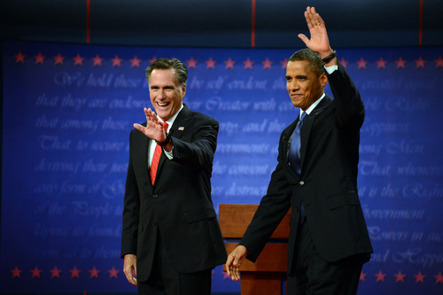President Barack Obama and former Massachusetts Governor Mitt Romney wave at the start of the presidential debate at the University of Denver Wednesday, Oct. 3, 2012, in Denver. (AP Photo/The Denver Post, John Leyba)