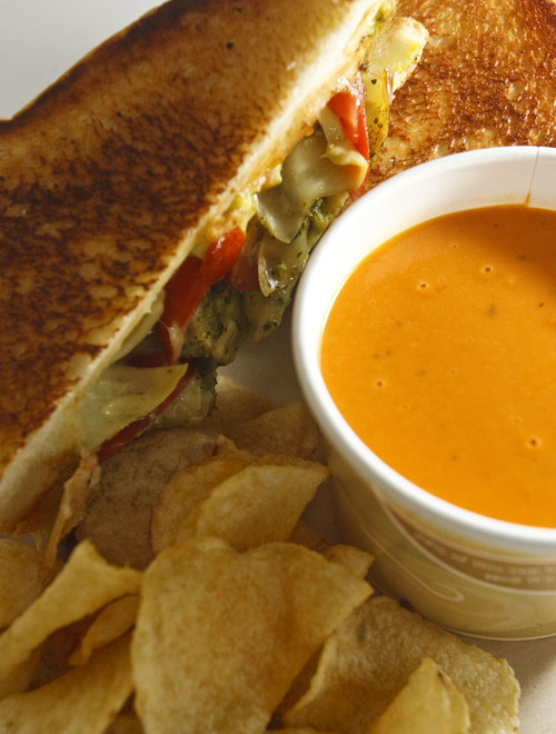 Leah Hogsten  |  The Salt Lake Tribune The artichoke and tomato grilled cheese with a cup of tomato basil soup at the Melty Way, a fast-casual restaurant in Midvale that is putting a grown-up spin on grilled cheese sandwiches.