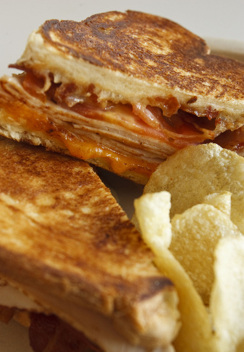 Leah Hogsten     The Salt Lake Tribune The turkey club with aged cheddar and smoked turkey with bacon and tomato at Melty Way, a fast-casual restaurant in Midvale that is putting a grown-up spin on grilled cheese sandwiches.