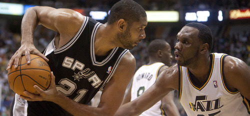 Jeremy Harmon     The Salt Lake Tribune  Tim Duncan is defended by Al Jefferson as the Jazz host the Spurs in the first round of the NBA playoffs at EnergySolutions Arena in Salt Lake City, Saturday, May 5, 2012.