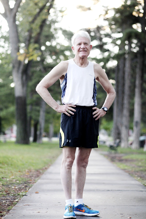 Ashley Detrick  |  The Salt Lake Tribune Jim Michie, 74, poses for a portrait before a run at Liberty Park on Wednesday, Oct. 3, 2012, in preparation for the St. George Marathon this weekend. This marathon will be Michie's 50th since he started running 34 years ago.