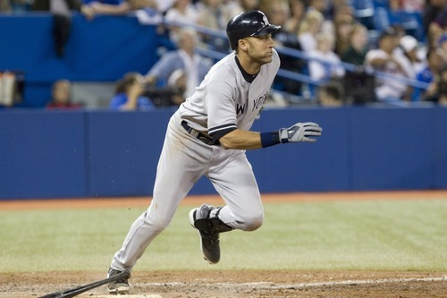 New York Yankees Derek Jeter breaks for first base after hitting a single to drive in Brett Gardner against Toronto Blue Jays during eighth inning of a baseball game in Toronto on Sunday, Sept. 30 , 2012. (AP Photo/The Canadian Press, Chris Young)