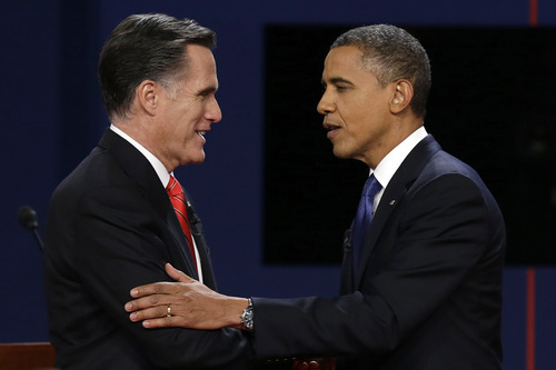 FILE - In this Oct. 3, 2012 file photo, Republican presidential nominee Mitt Romney and President Barack Obama shake hands after the first presidential debate at the University of Denver, in Denver. Both men relished the wonky talk, but Mitt Romney also showed the easy confidence a presidential contender needs _ and a bit of the salesman's dynamic presentation. Barack Obama sounded more like a long-winded professor a little annoyed he has to go over this stuff one more time for the slow students in the back. For viewers the lesson from both was clear: If they crave a real discussion of complicated issues _ not just zingers _ it means some tough going.  (AP Photo/Charlie Neibergall, File)