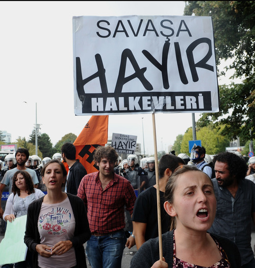 Turks hold banners that read