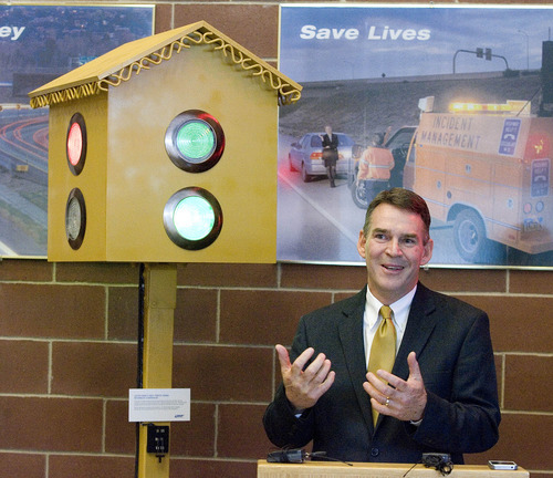 Paul Fraughton |  The Salt Lake Tribune Utah Department of Transportation Executive Director John Njord stands Thursday in front of a replica of the traffic signal invented by Lester Wire in 1912 and installed at the intersection of 200 South and Main Street in Salt Lake City.       Thursday, October 4, 2012